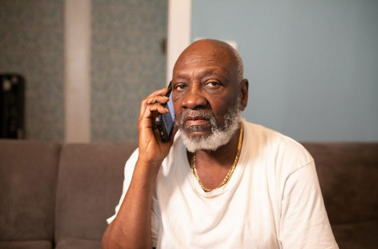 Elderly man using a mobile phone